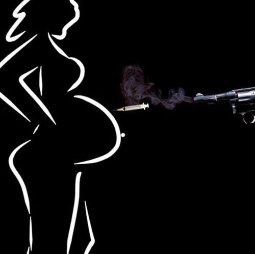 Gun-Firing-Vaccine-Bullet-at-Pregnant-Woman1