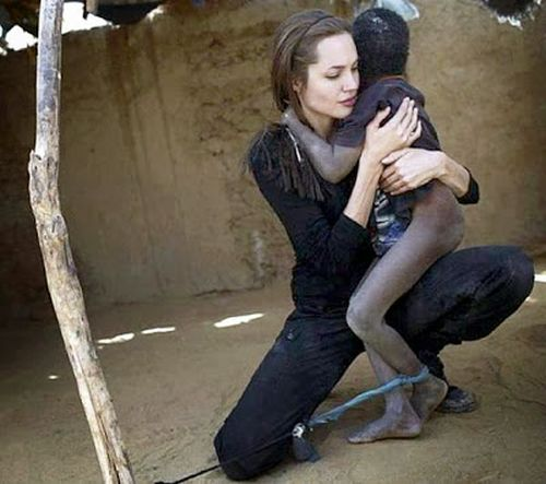 angelina jolie hugs african child with nodding disease